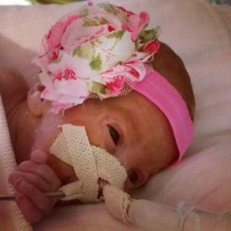 NICU champ Azlan wearing a gifted floral bow