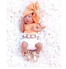 Tiny Azlyn looking super stylish in her mini moccs and oversized bow